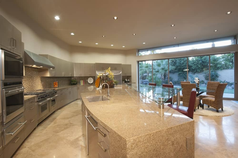 Open-concept kitchen with recessed lights, stainless steel appliances, and an island.
