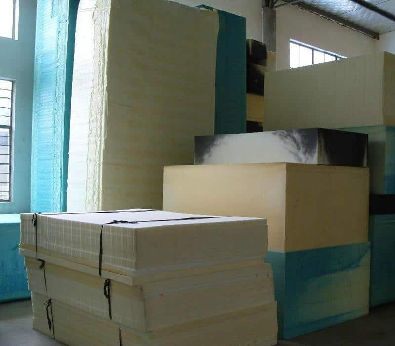 Stacks of reinforced polyurethane foam board are stored in a warehouse.