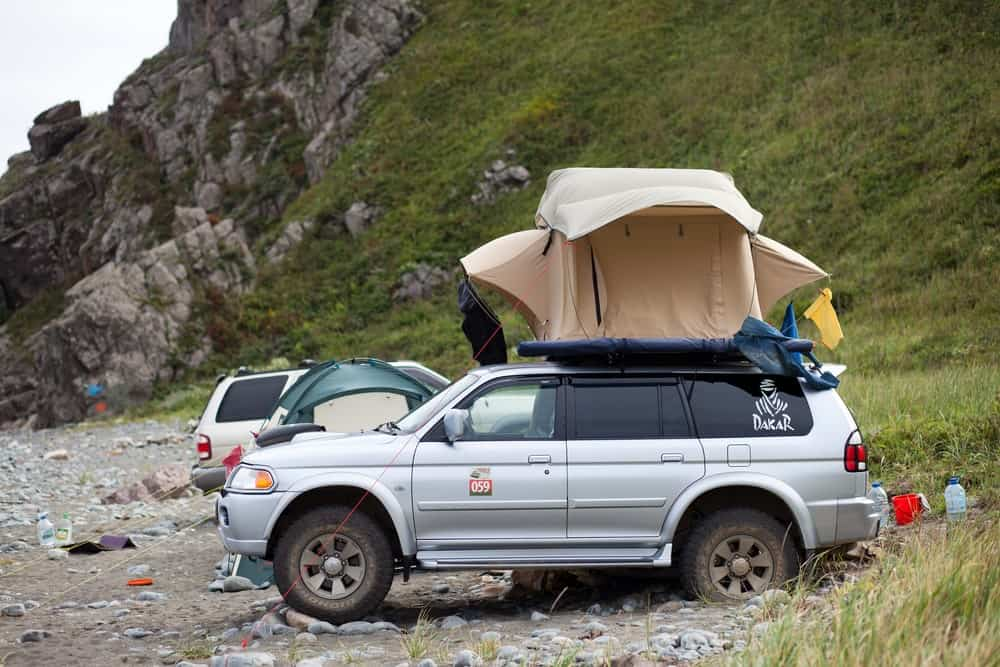 A rooftop tent set up above an SUV.