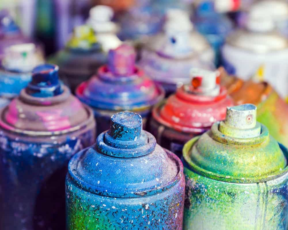 Used cans of spray paint.