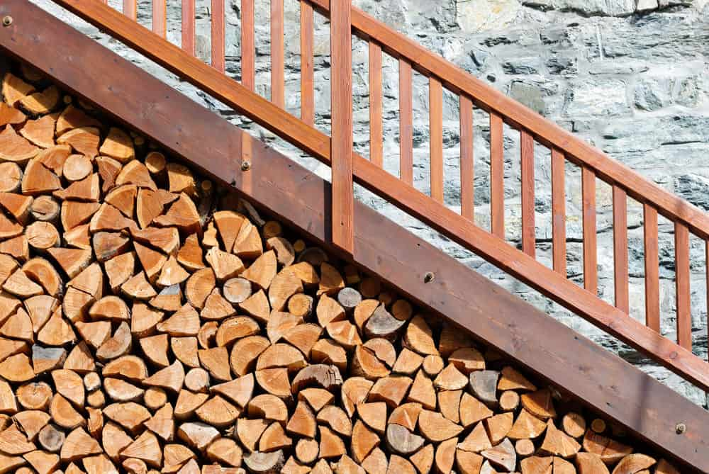 Functional firewood storage on exterior staircase.
