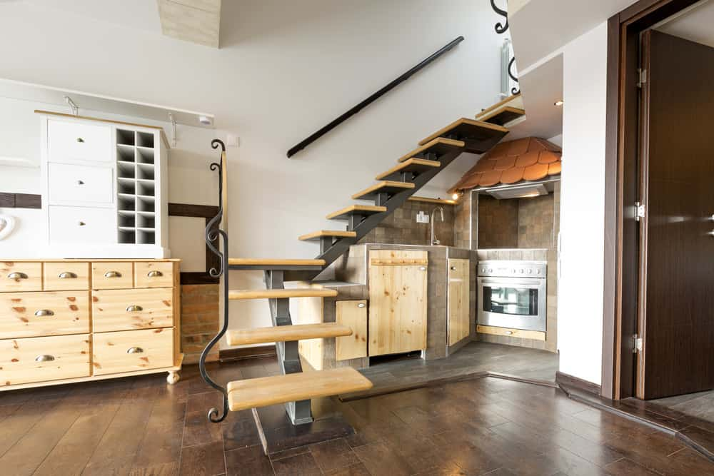 Kitchen Built Underneath Modern Open Staircase.
