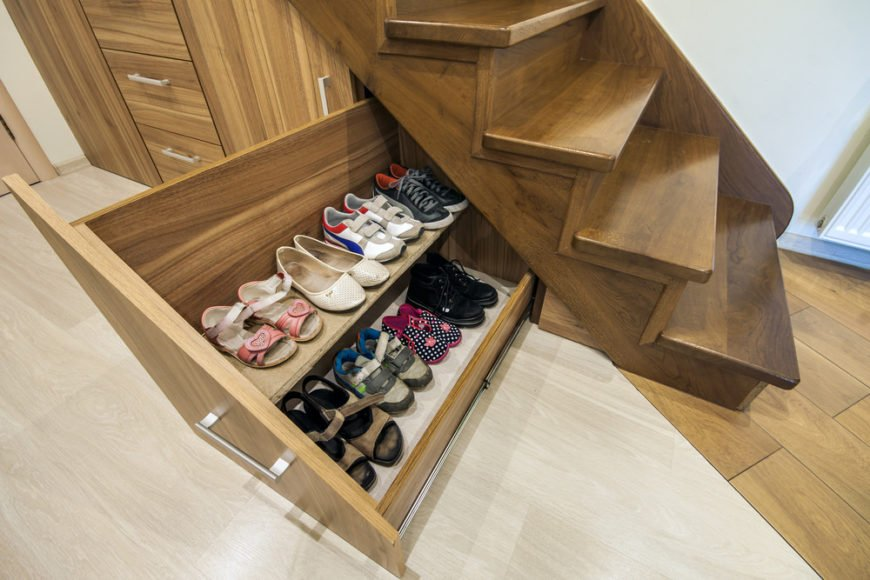 Stairs with storage drawers and shoe storage underneath.