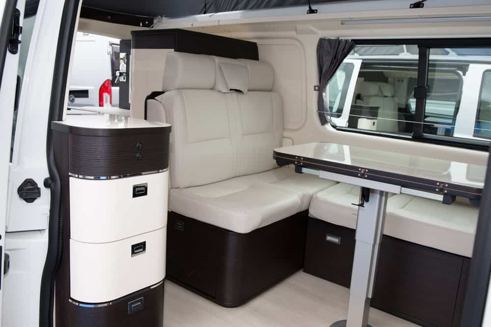 Interior view of a tent trailer with storage compartments.