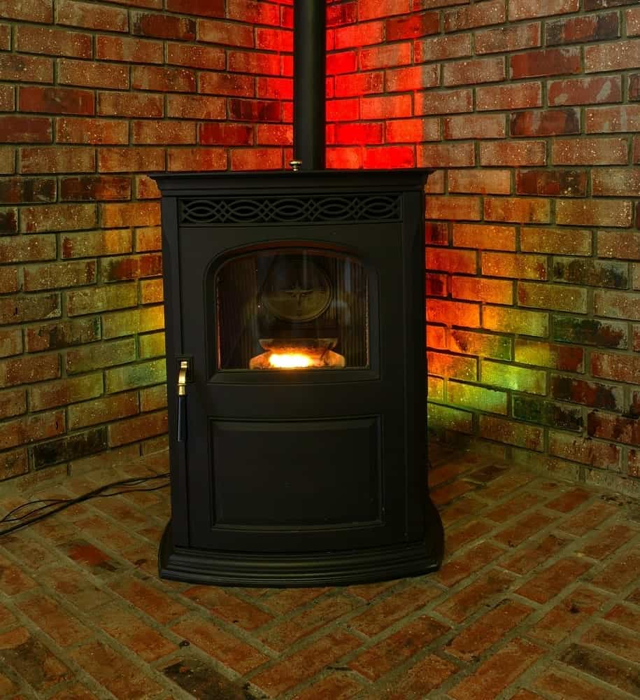 Modern stove pellet on brick wall and flooring.