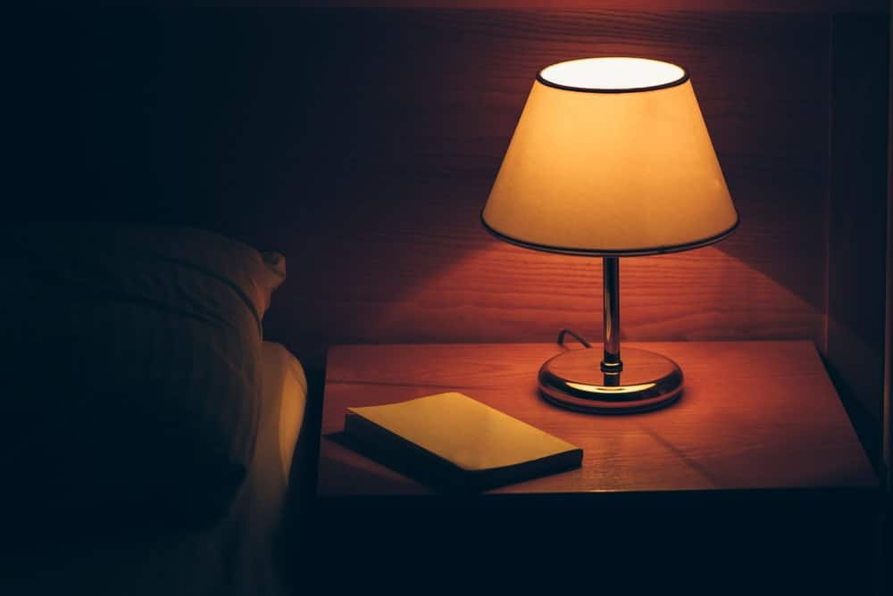 Table lamp on bedside table.