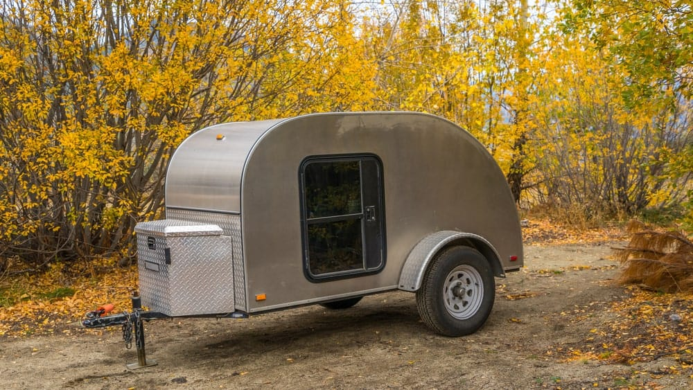 Teardrop trailer isolated in the woods.