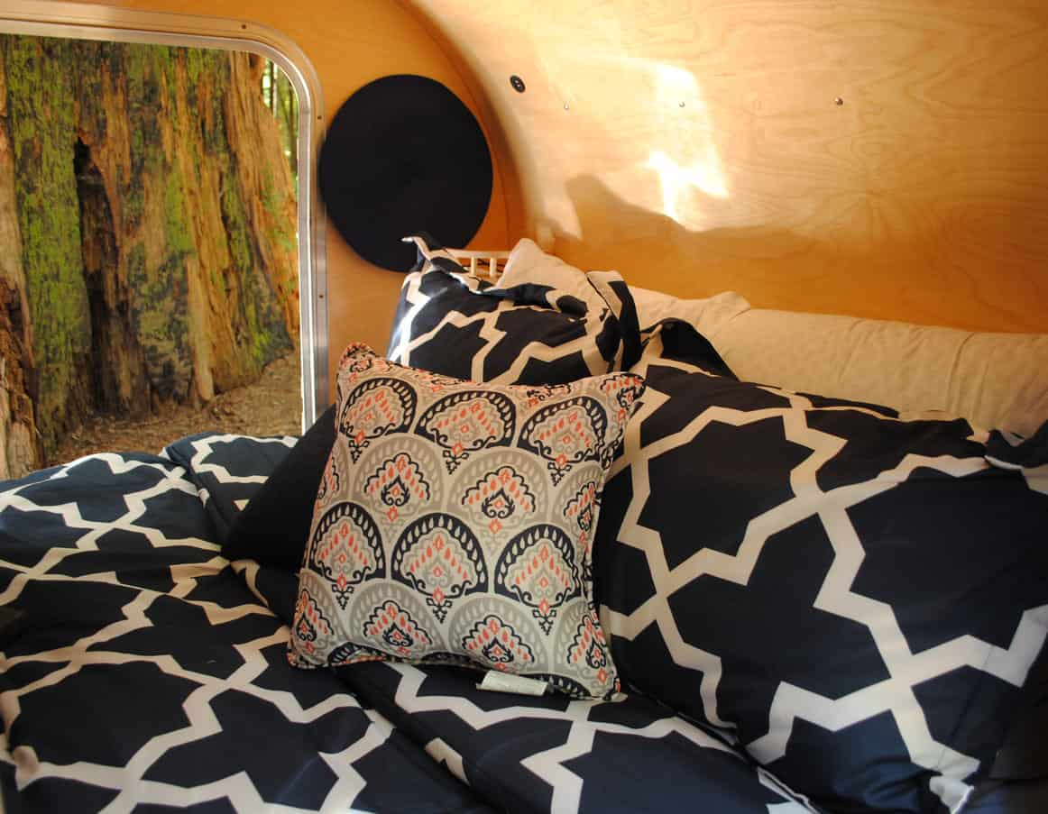 The sleeping compartment of a teardrop trailer.