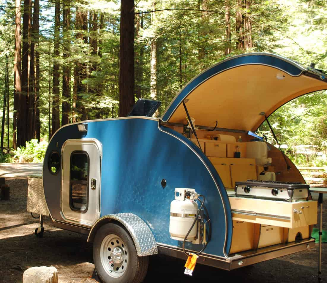 Side view of a teardrop trailer with kitchen hatch.