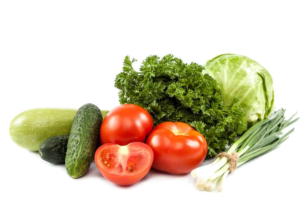 Fresh vegetables on white background.