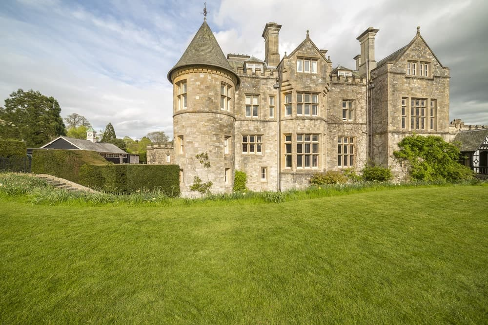 Victorian castle on grassland with triangular roofing.