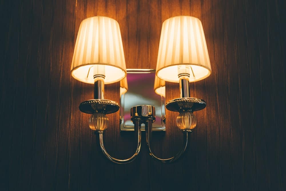 Wall lamp on wooden walls.