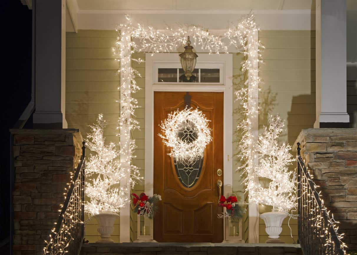 I love this front door entrance with icicle style lights wrapping around the door along with the icicle lit wreath.  This is very easy to do and looks fabulous.
