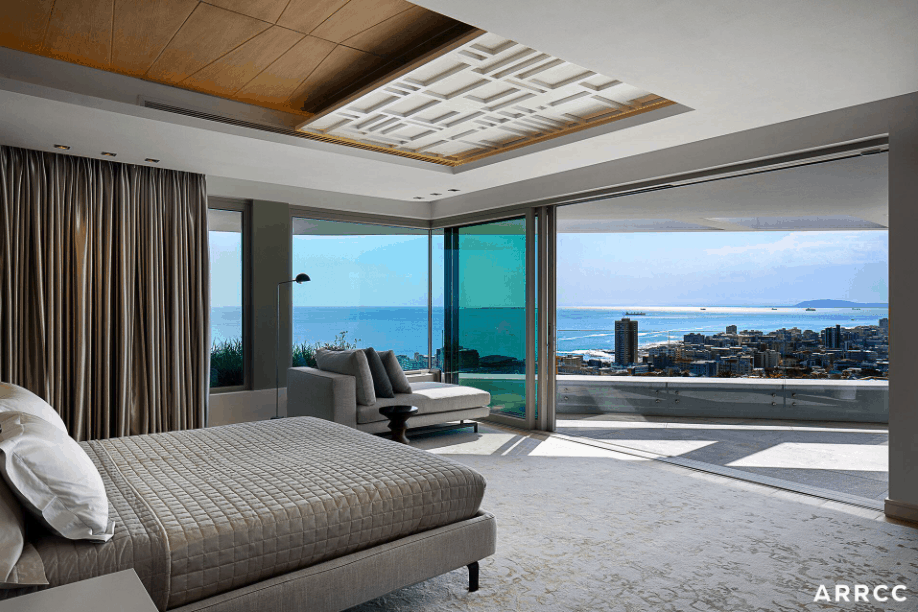Look at that balcony and view from this contemporary master bedroom that's spacious yet not cluttered.