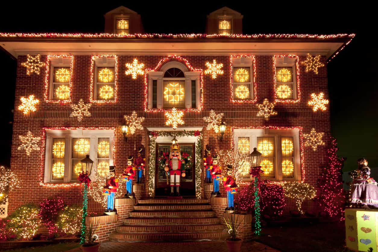 Here's an example of a tastefully decorated elegant older brick home.  It's not over the top.  I love the Nutcracker characters standing on guard along the stairs to the front door.