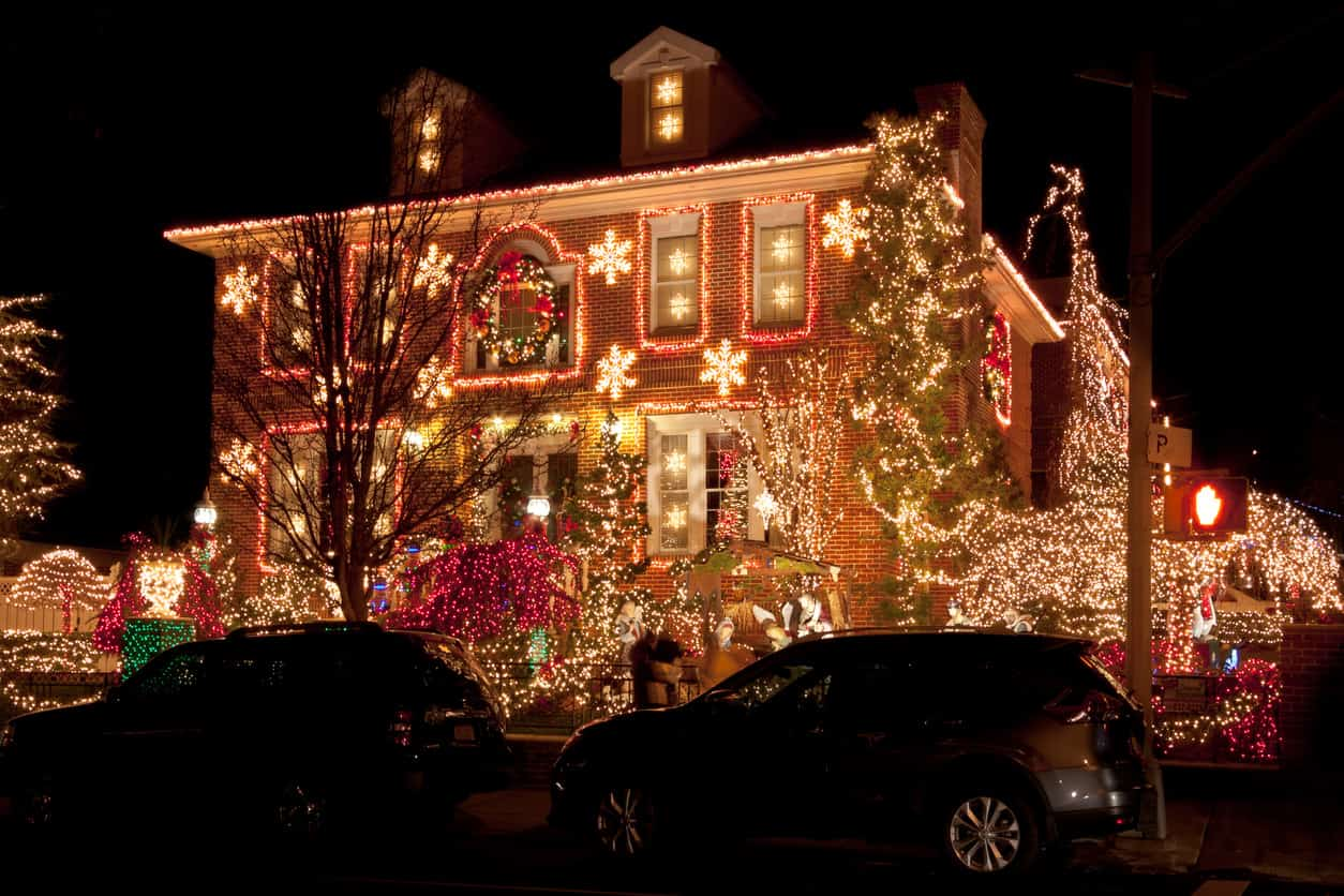 This brick home has lights and lit snowflakes everywhere.  I like the red and white lights wrapping around all the windows.
