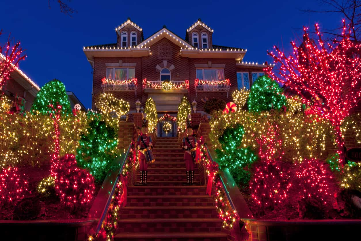 This large front yard with many trees and bushes offers many lighting opportunities.  All the trees are lit up with green, white and red lights.  Notice how each bush or tree has its own color.  That's the effect I really like and do with our house.