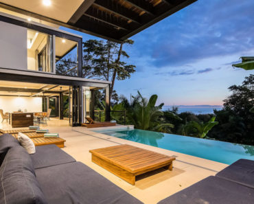 Covered patio with infinity pool overlooking the jungle and Pacific Ocean.