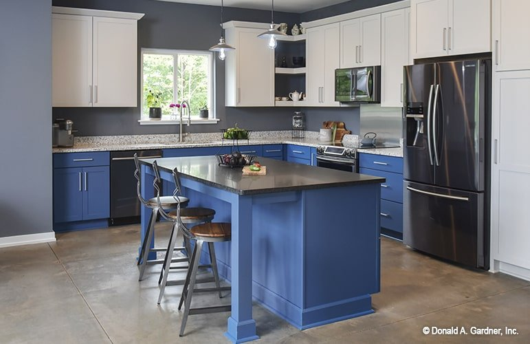 Blue island and lower cabinets bring a nice interest to this modern kitchen. It goes well with the white upper cabinets and slate appliances.