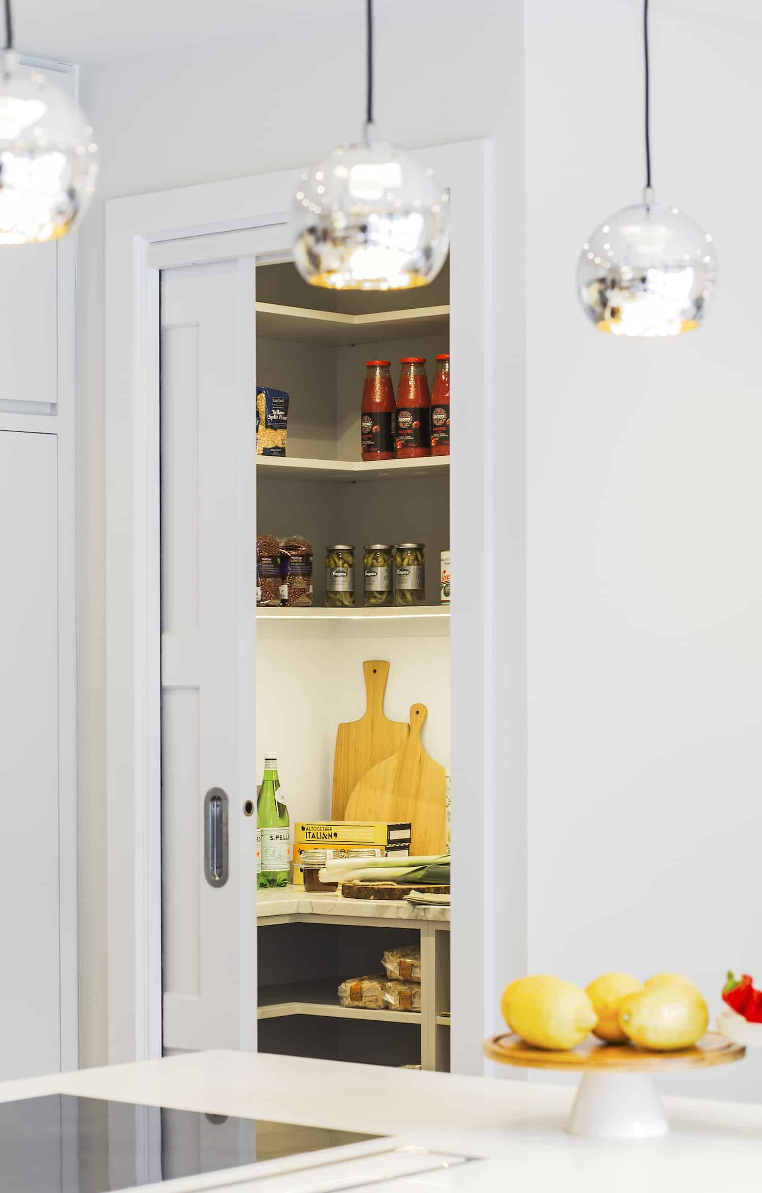 Kitchen storage was a focus in this kitchen design. Here's a small kitchen pantry off the kitchen space.