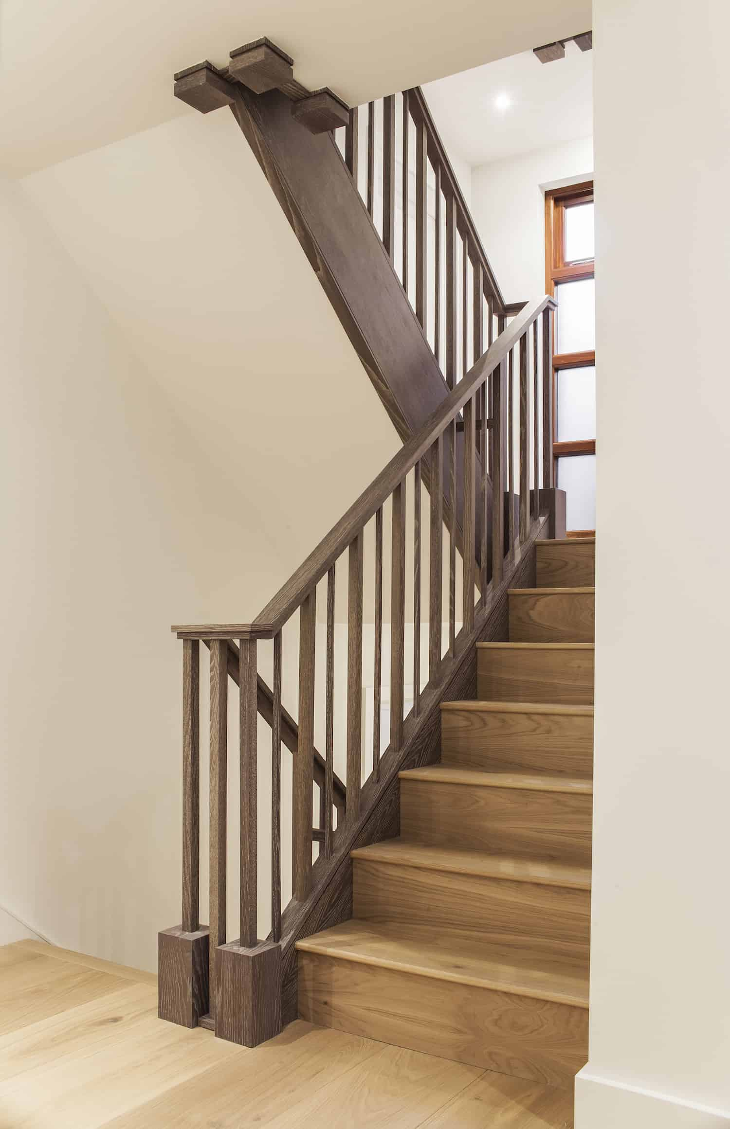 LLI Design incorporated the same staircase styling throughout all 5 floors in this townhouse.
