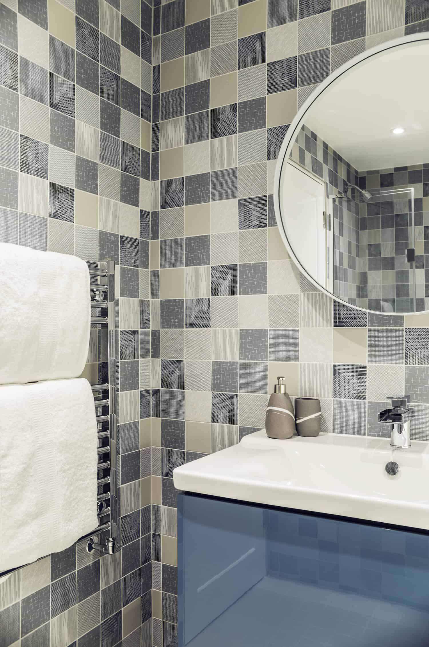 "The kids bathroom is, in my view, thoughtfully designed for both kids and for guests. It's visually interesting with a multi-checked tile but not done so in an obnoxious ""kid"" style. The vanity, sink and mirror offer a touch of retro style as well."