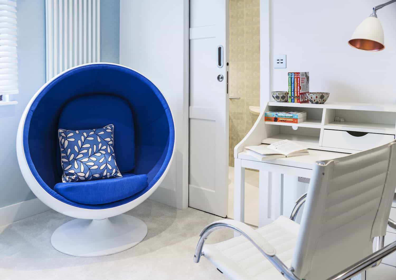 The kids bedroom includes a space pod chair that kids love. There's also a white desk with comfortable modern white desk chair.