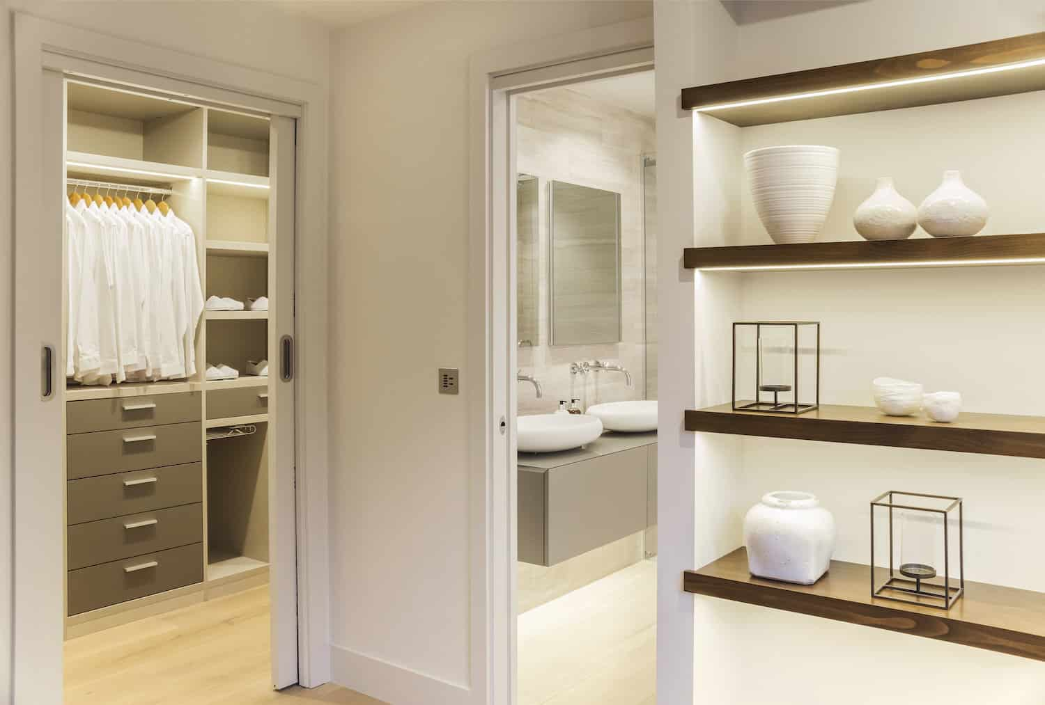 LLI Designed knocked it out of the park with the primary bedroom, walk-in closet and en suite. Here's a photo showing the walk-in closet and part of the primary bathroom viewed from the primary bedroom.