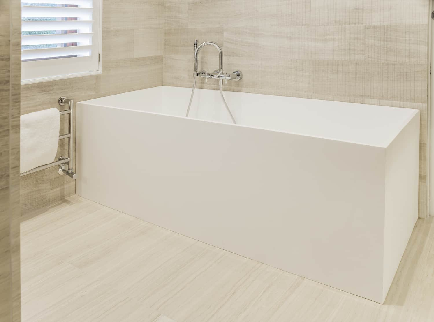 Here's the deep, rectangle white tub in the master bathroom. The tub is very angular which juxtaposes nicely with the rounded vessel basin in the same bathroom.