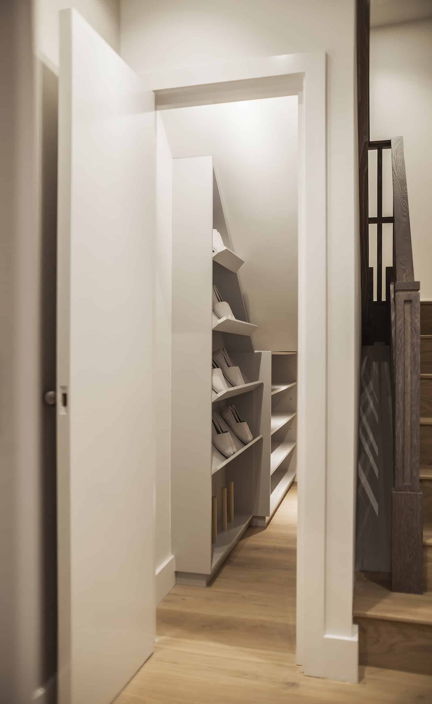 Renovation resulted in new stylish staircase with a storage closet underneath with capability to store shoes and other items.