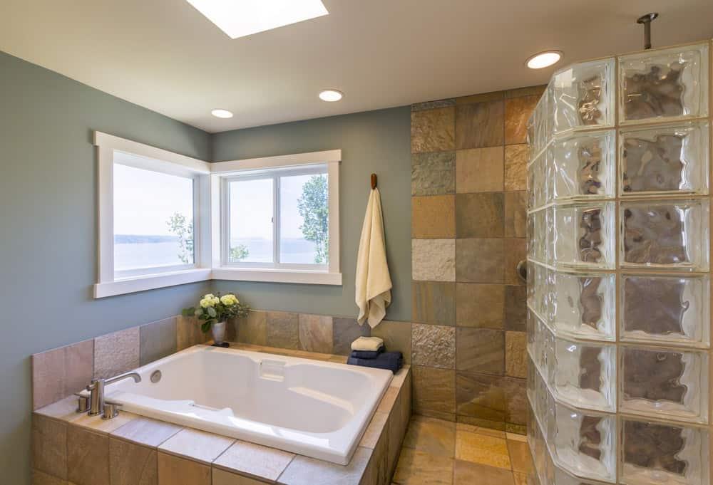 Bathroom with slate floor and wall