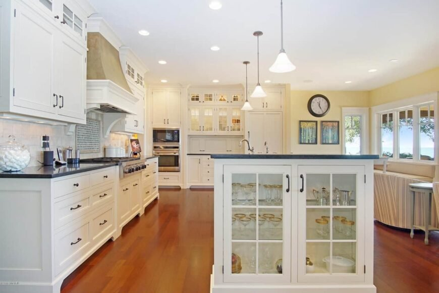 Beautiful white kitchen design in large beach house