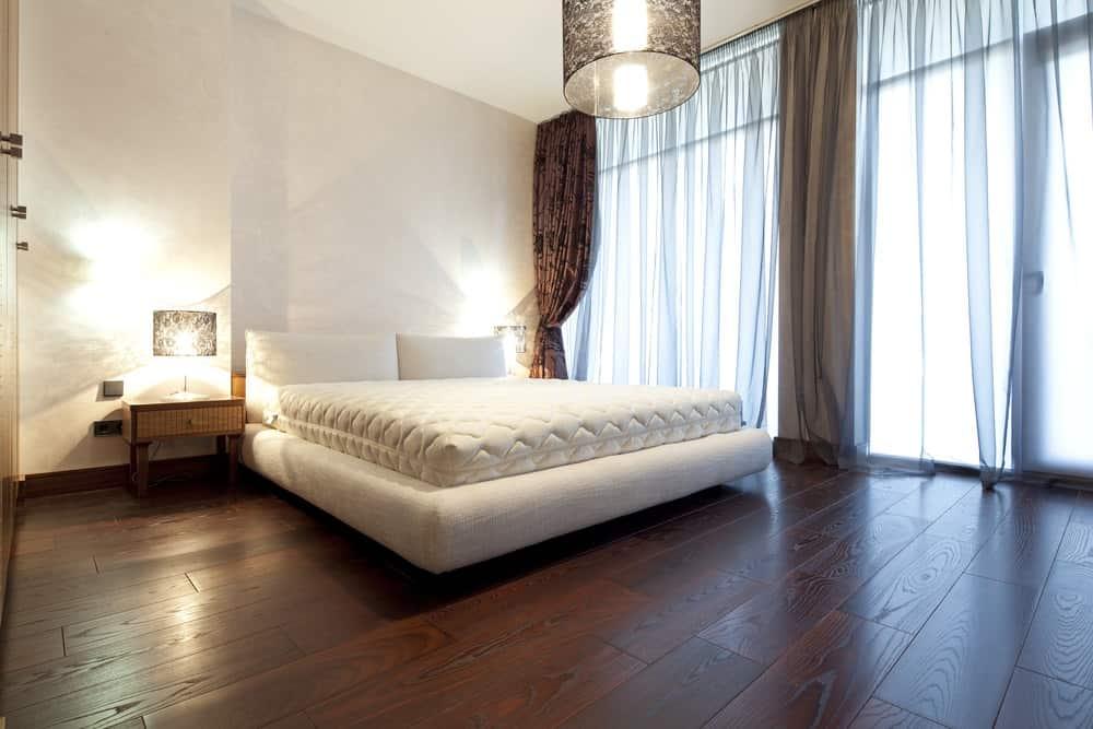 Bedroom with mahogany hardwood flooring