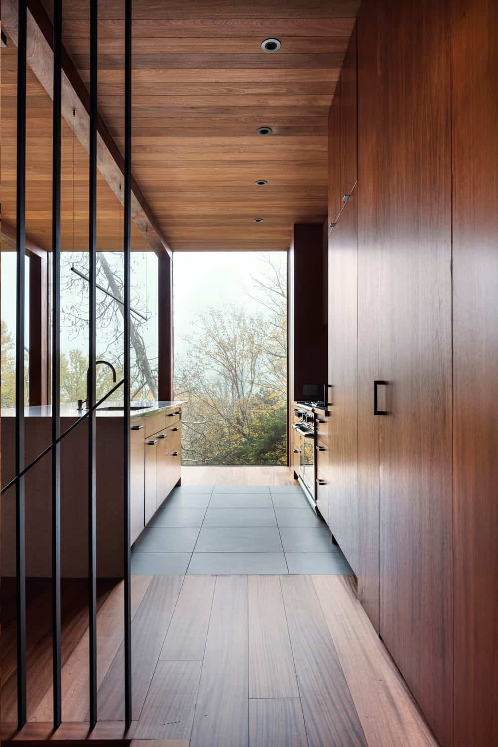 Modern kitchen with all wood cabinetry, flooring, island and ceiling by yh2 architectes