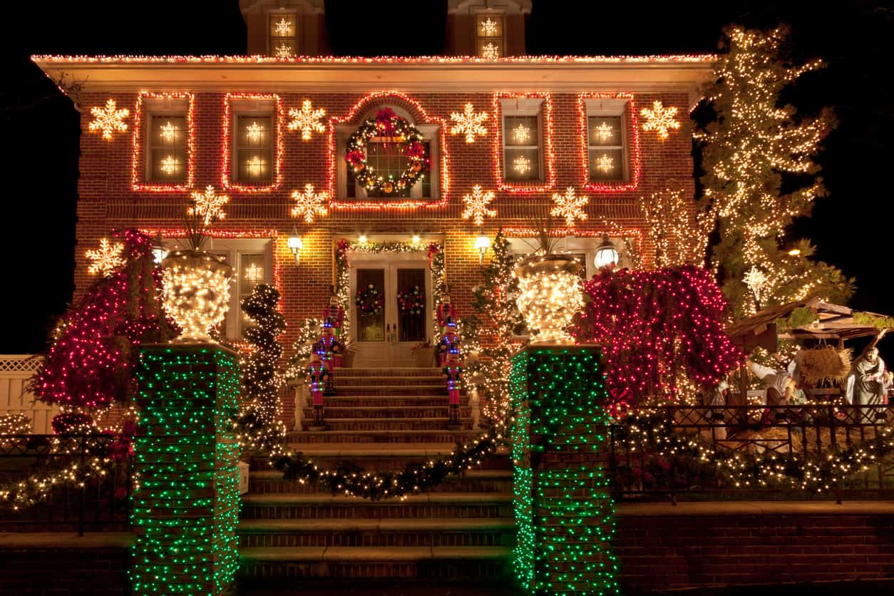 House with white and red Christmas lights