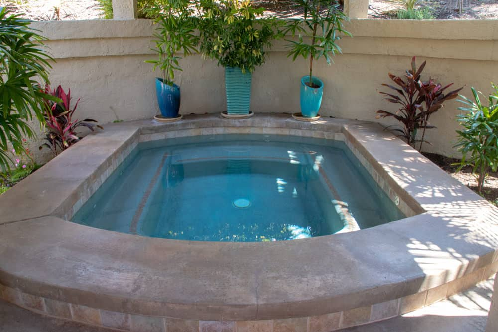 In-ground hot tub in the backyard