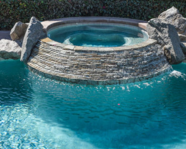In-ground hot tub next to swimming pool