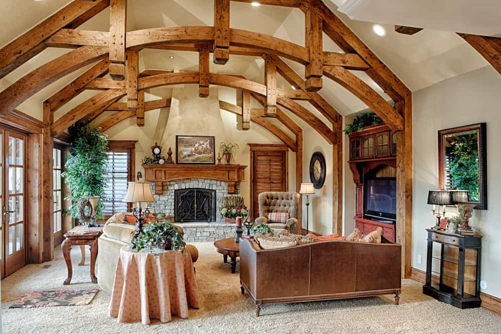 Incredible living room with cathedral ceiling including natural exposed beams