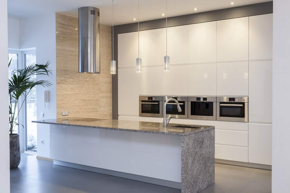 Kitchen with travertine wall.
