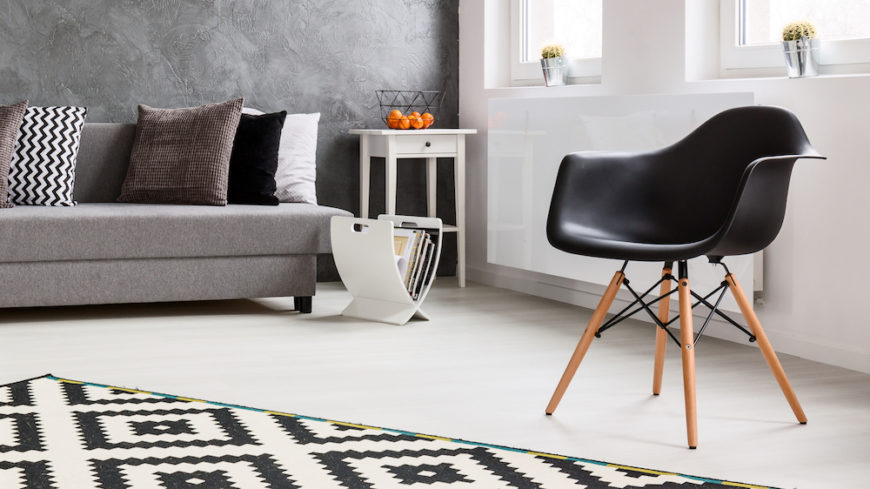 Living room with a modern white magazine rack on the floor