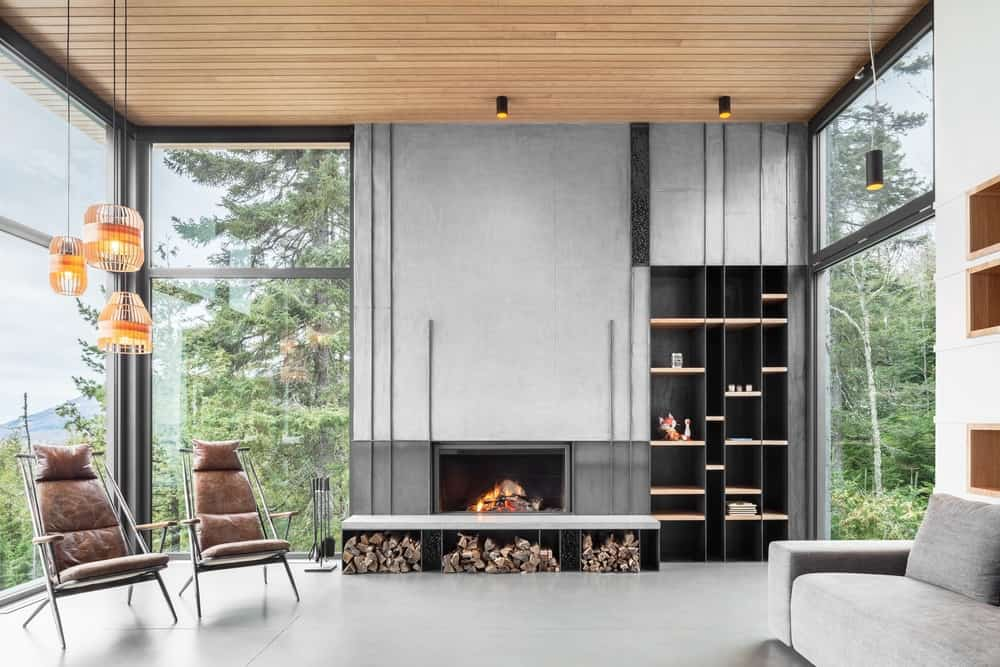 A combination of concrete, wood and glass rolled into a beautiful and warm interior of the house. Floor-to-ceiling windows allow natural light in and provide a calming view of the majestic forest.
