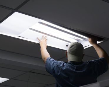 Man installing fluorescent lights
