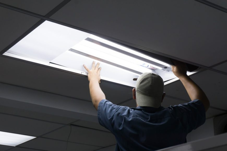 Man installing fluorescent lights