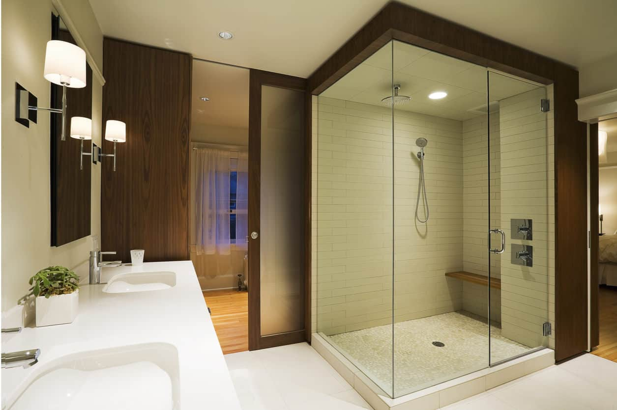 Fabulous wood-framed walk-in shower is the star of this master bath that includes a two entry points.