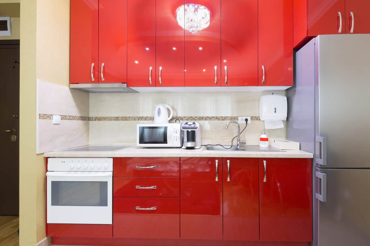 Small red modern kitchen in an apartment