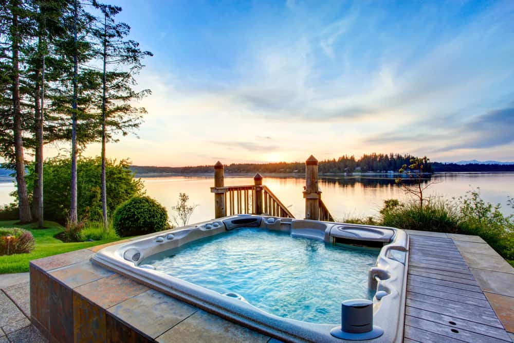 Square hot tub on patio with view
