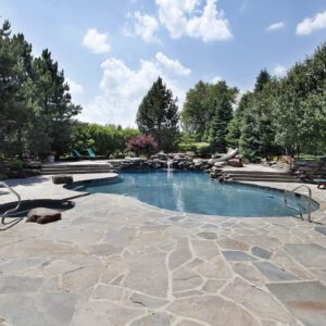 Swimming pool with large flagstone patio