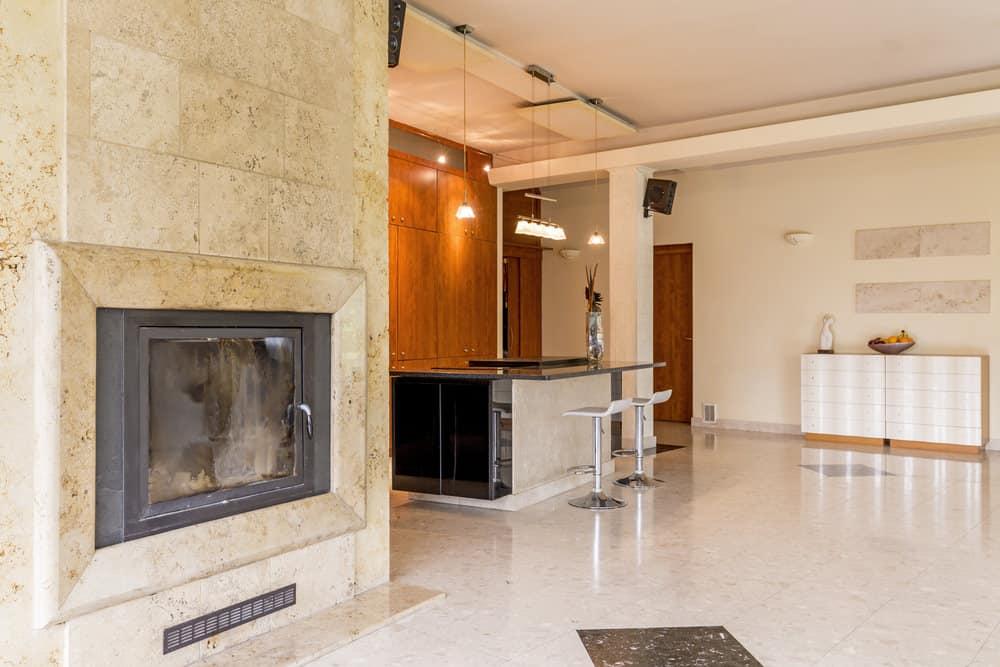Travertine fireplace.