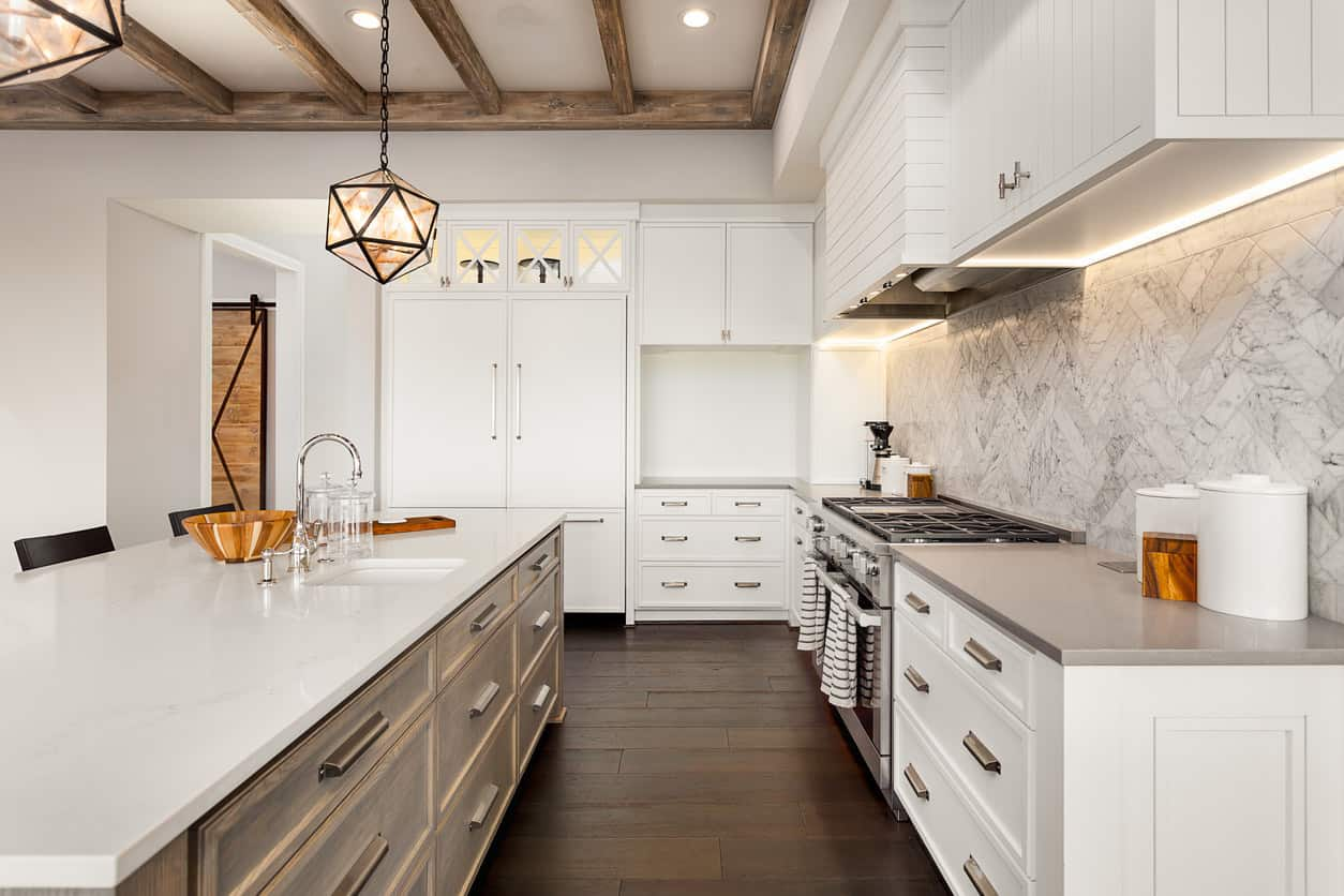I know you've been waiting for the rustic white kitchen example. Here it is in all its rustic glory. Check out those wood beams and slightly distressed wood island along with rustic pendant lights. It's not over the top, but it's enough rustic to look really good.