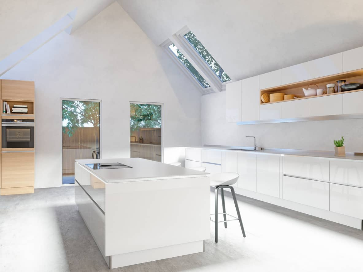 Here's an interesting white kitchen with towering cathedral ceiling (all white), skylights and stark white kitchen space including floor. There's two splashes of light wood - a microwqve shelf and built-in open-faced shelf.